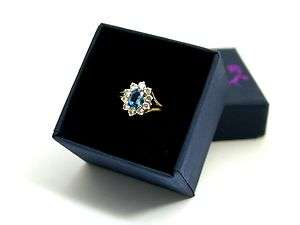 9ct Gold Ring set with Blue Topaz and Cubic Zirconia Ring Size O